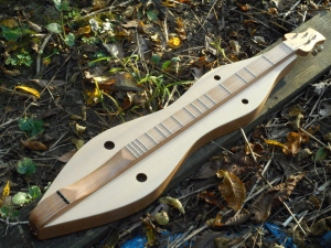 "North Carolina Hourglass (NCH model) with cherry back, sides, and fingerboard with spruce top. 26"" nut-to-bridge string length"